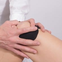 Athlete nursing injured knee