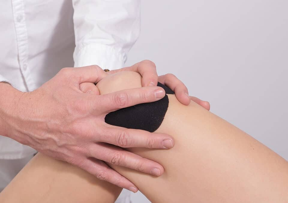 Athlete nursing injured knee