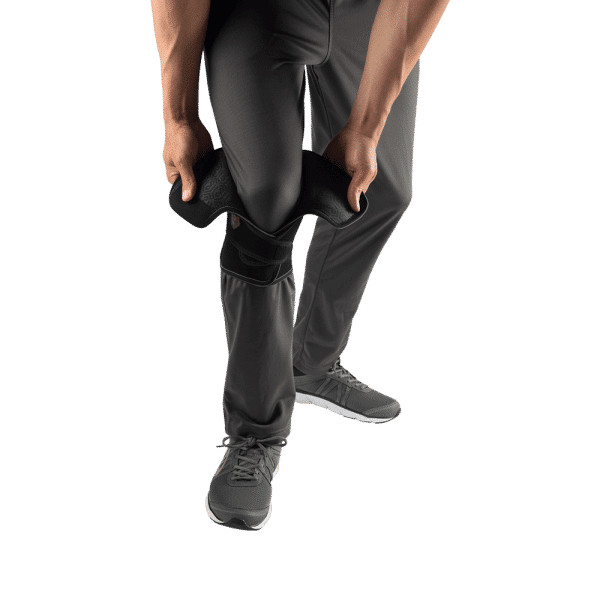 McDavid VOW™ Versatile Over Wrap Knee Wrap w/Stays worn over trousers