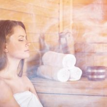 A woman enjoying a sauna - one of many forms of moist heat therapy.