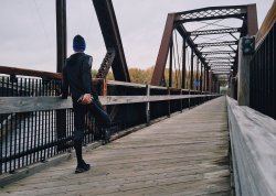 Man exercising on a bridge. Starting a physical exercise program can be one of the most effective treatments for diabetic neuropathy