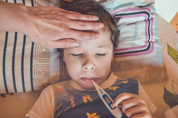 Child Having Temperature Measured With A Digital thermometer