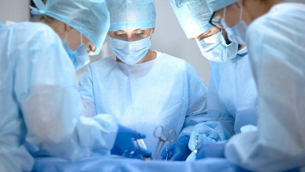 Surgeons in the operating room. These healthcare workers should choose Level 3 disposable masks for the highest protection possible.