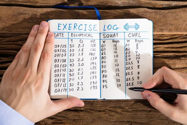 An exercise log book (pictured) can play a crucial role in improving patient compliance with physical therapy.
