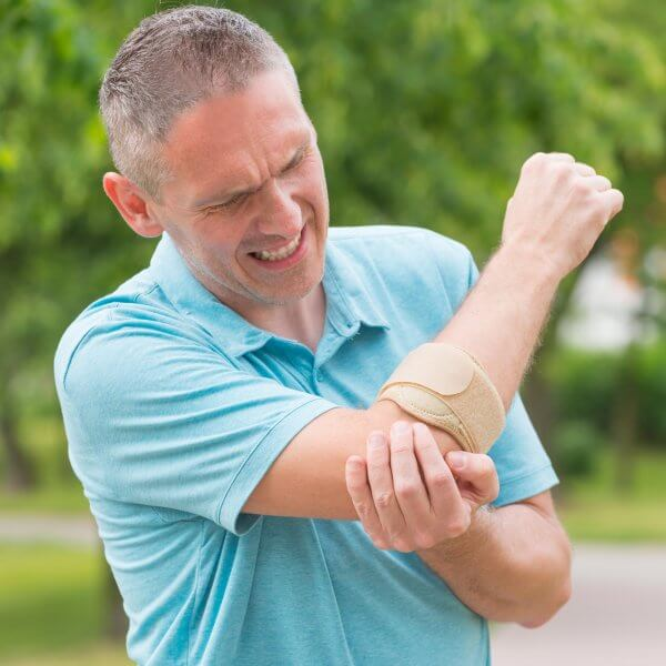 Man wearing tennis elbow brace