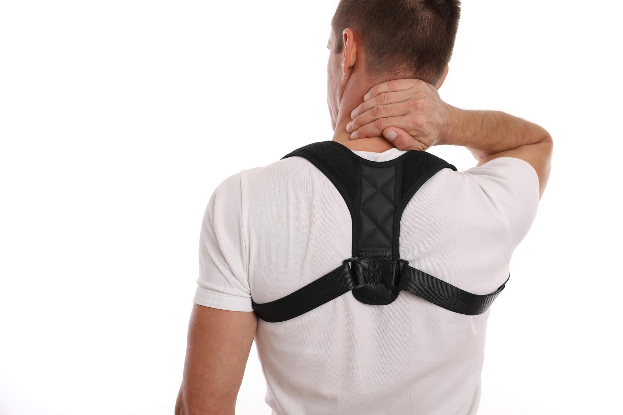 Man wearing posture brace