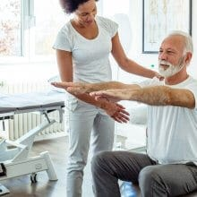 Patient performing physical therapy exercises