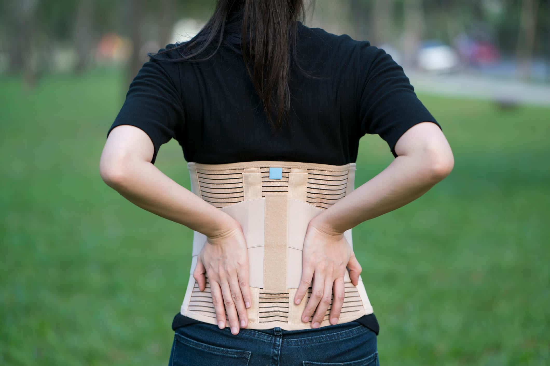 woman wearing a back brace