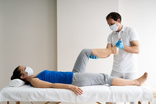 Therapist treating a patient. The  daily number of hours spent with patients is an important component of the daily data points for tracking clinic performance.