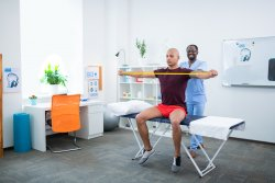 Physiotherapist At Work